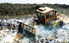 Bulldozer clearing rubbish at waste faciltity